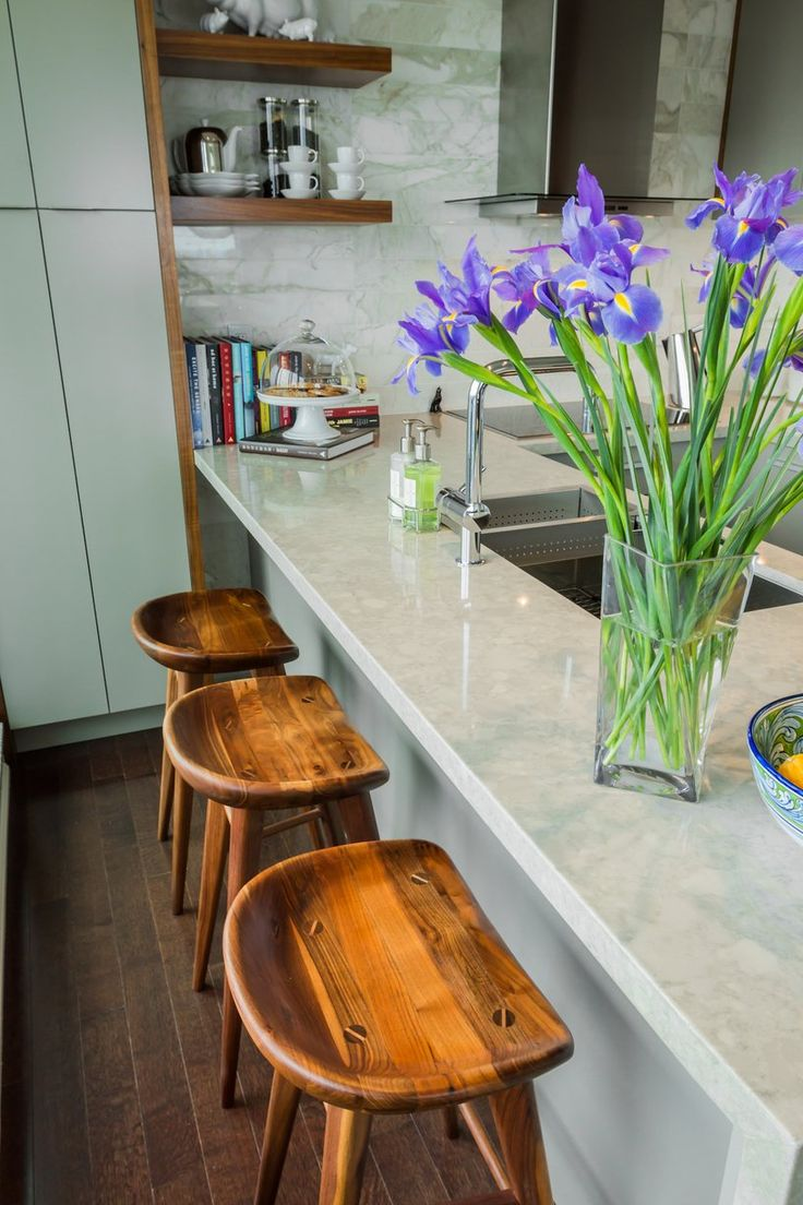 A place to sit in a small kitchen. Efficient uses of space!