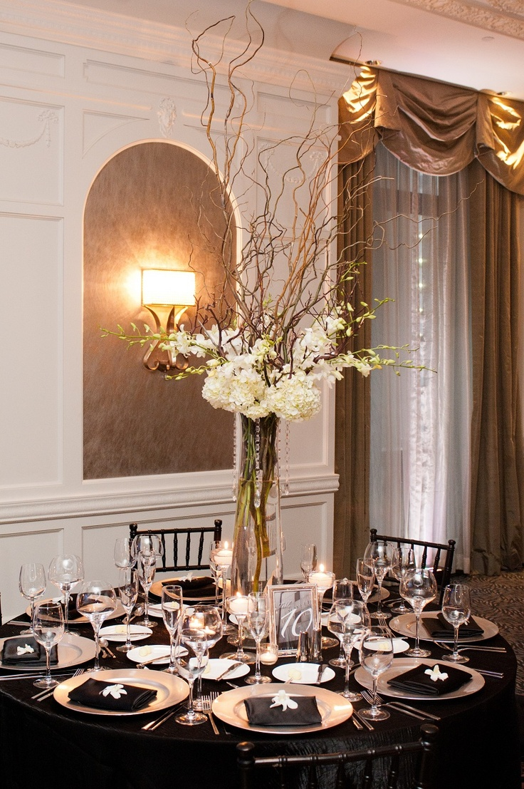their tall centerpieces were curly willow branches white hydrangea