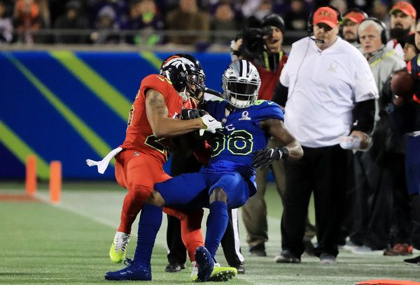 Dez Bryant Photos Photos - Chris Harris Jr #25 of the AFC tackles Dez Bryant #88 of the NFC in the first half during the NFL Pro Bowl at the Orlando Citrus Bowl on January 29, 2017 in Orlando, Florida. - Pro Bowl
