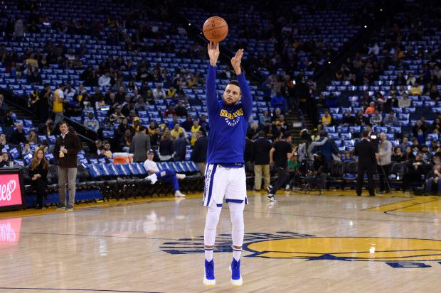 Golden State Warriors' Stephen Curry (30) shoots before the start of their NBA game against the Los Angeles Lakers at the Oracle Arena in Oakland, Calif. on Friday, Dec. 22, 2017. Curry is still not playing due to an ankle injury on Dec. 5th. (Jose Carlos Fajardo/Bay Area News Group)