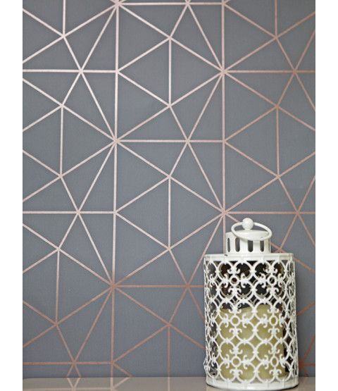 This Metro Prism Geometric Triangle Wallpaper in Charcoal and Copper features stylish metallic elements. Part of the World of Wallpaper Metro Collection. Free UK delivery available.