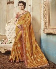1. Golden pure silk sari 2. Two tone zari boota sari with exclusive hand made cut work border & embroidery 3. Comes with a matching embroidered art silk unstitched blouse