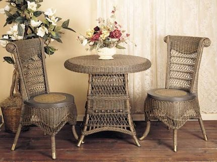 Classic Tea Table Set - Once an afternoon ritual among noble ladies of the Victorian era, tea times can extend into evening or begin with a gathering for morning coffee. In a classically ornate design featuring vintage finish choices, this three-piece set is one to be enjoyed in a kitchen nook or a sunroom. Two wicker chairs feature such traditional features as rolled crests on high backs and scalloped skirting with ballooning at the knees.