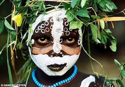 Natural Fashion: Tribal Decoration from Africa by Hans Sylvester.   saw this at country bookshelf last year...fascinating..
