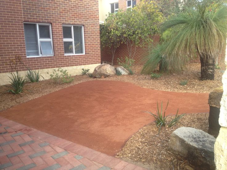 Red crushed rock path and garden design by Aden