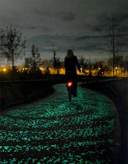 "Van Gogh Bicycle Path Illuminated bike path designed by Daan Roosegaarde glows in the dark and allows people to safely ride their bicycles at night. Beautiful cycling path was inspired by Vincent van Gogh's classic painting ""The Starry Night"". Constructed by Heijmans in Eindhoven, Netherlands. Made out of thousands of solar powered sparkling lights / stones."