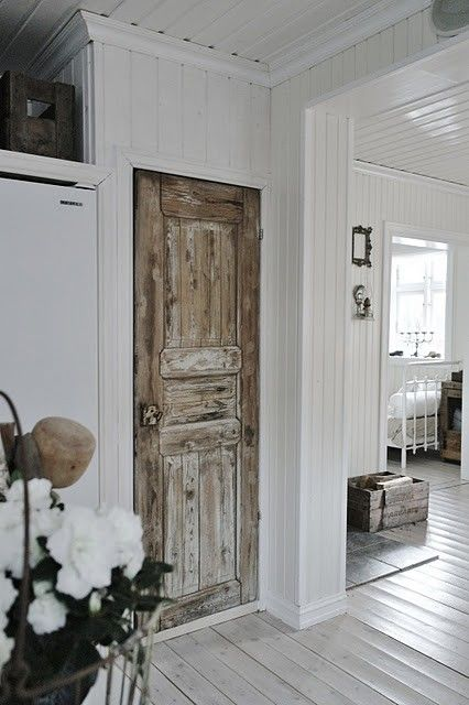Like this look! Use an old door with worn finish to add some charm to the white walls and ceiling...