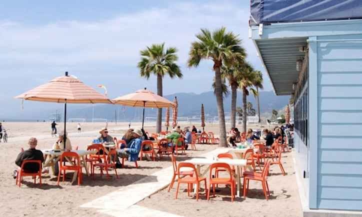 """Take your """"nightlife"""" outside with these best beachside bars in LA including Back on the Beach Cafe in Santa Monica."""