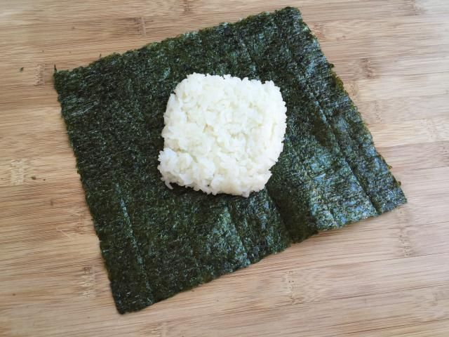 Learn How to Make Onigirazu Rice Ball Sandwiches, Step-By-Step!: Step 1: Place Rice on Dried Seaweed (Nori)