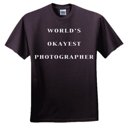 World's Okayest Photographer T Shirt, $19.99 http://www.theteemerchant.com/shop/view_product/World_s_Okayest_Photographer_T_Shirt?c=1140152&ctype=0&n=5331482&o=0
