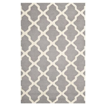 Wool rug with a Moroccan trellis motif. Hand-tufted in India.  Product: RugConstruction Material: Wool
