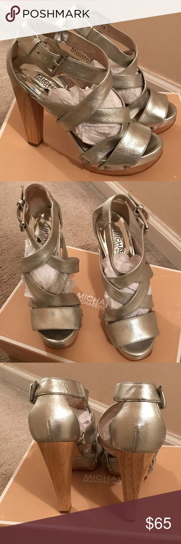 Michael MICHAEL KORS Silver Strappy Sandals Sz 5.5 Michael MICHAEL KORS Silver Strappy Sandals Sz 5.5. Gorgeous silver Strappy sandals for almost any occasion. Perfect with sundresses, jeans or capris. These sandals can be worn with anything. Gently used GUC 🚫Trades, paypal, any questions in the comments regarding price please use the offer button or they will be ignored🚫 Michael Kors Shoes Sandals