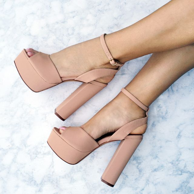 Channel your fave seventies bae in these sky-high platform heels! #heels…