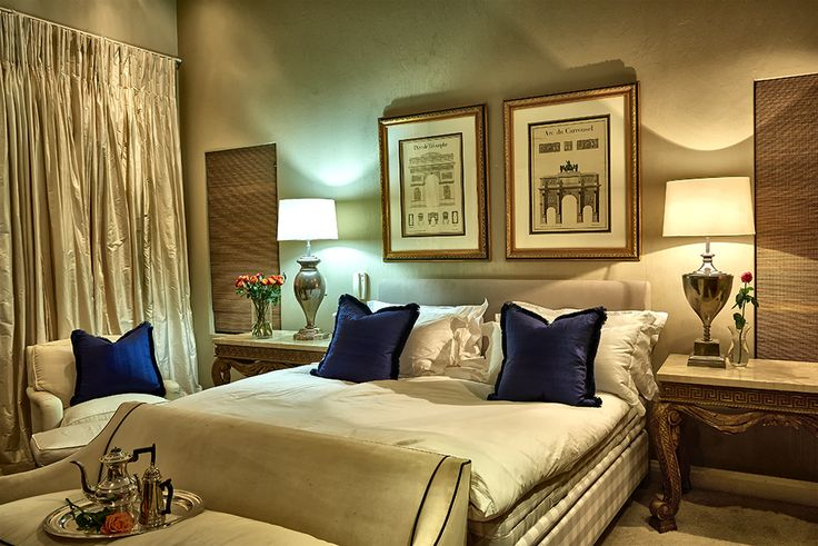 A sophisticated, stylish home in Johannesburg, showcasing a creative mixture of colours, styles and textures. Abundant use of original artworks and strong colour statements. Classical style bedroom with comfort reigning supreme.