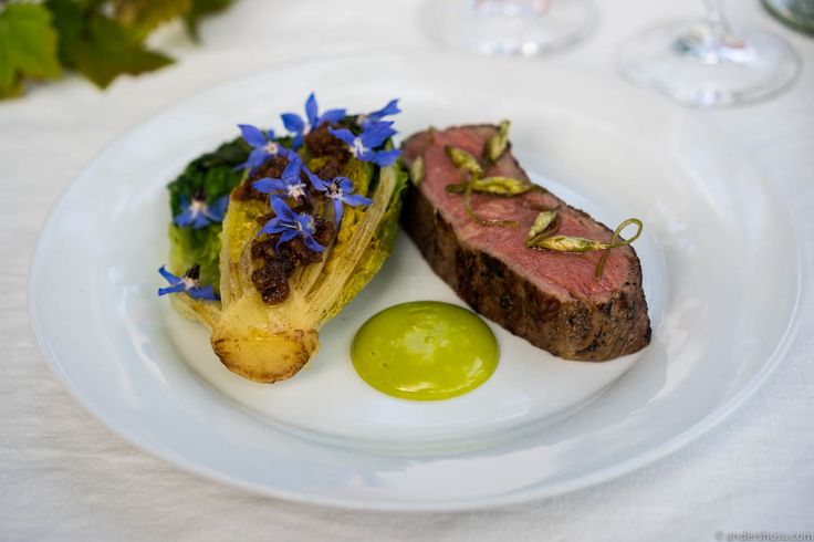 Sirloin of organic, grass-fed Aberdeen Angus beef from Horgen Gård, grilled little gem salad with crispy fat, ramson emulsion, pickled ramson flowers & starflower