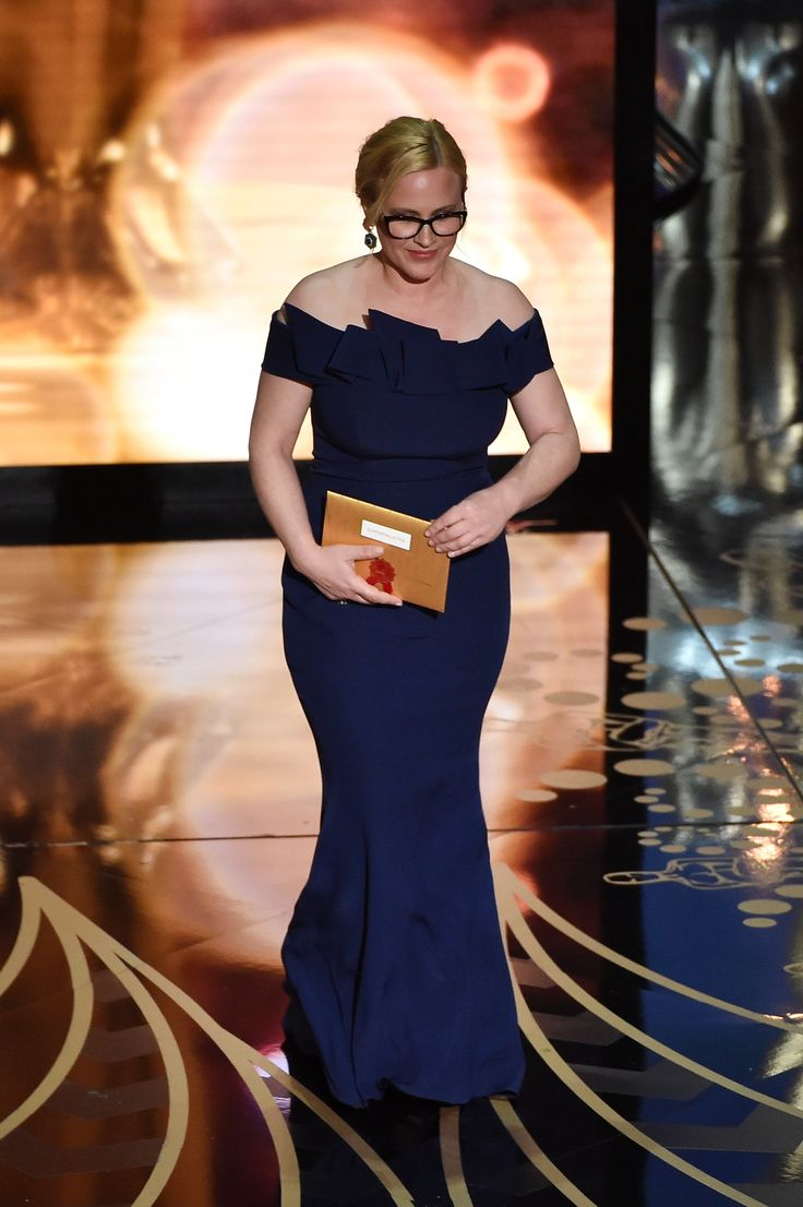 Patricia Arquette chose a Marina Rinaldi midnight blue elegant gown to wear at the 2016 Academy Awards ceremony.