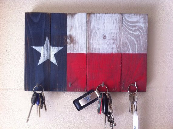 Painted, sanded for a rustic, vintage look, with 4 hooks. I want to make one of these :) Super cute and easy!