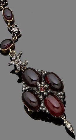 """A garnet diamond necklace, pendant/ brooch, circa 1850. The necklace alternately-set with cabochon garnets and old brilliant-cut diamonds, suspending a similarly-set detachable lozenge-shaped pendant, later brooch fitting, necklace."""