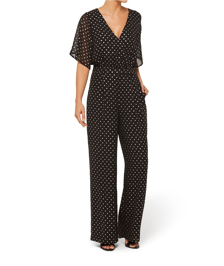 Your Saturday night is sorted with the Metallic Spot Jumpsuit. This woven all-in-one features wrap front, elastic waistband, keyhole & button back with zipper closure.