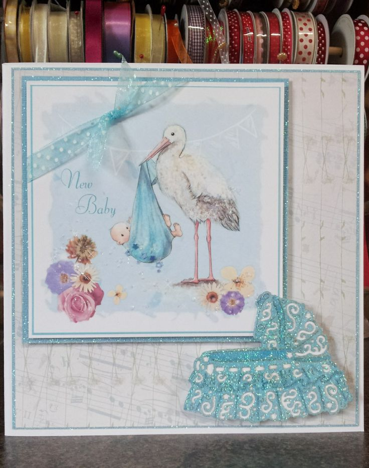 A gorgeous new baby card made using Wishes  Whispers cd with mini gems, ribbons and the Tattered Lace crib die.