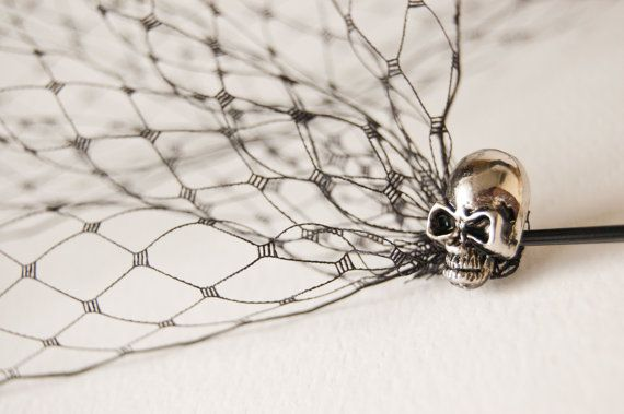 This bandeau style birdcage veil attached to two bobby pins. Pins decorated with silver color metal skulls.    Veil size approximately 14 by 9 (32