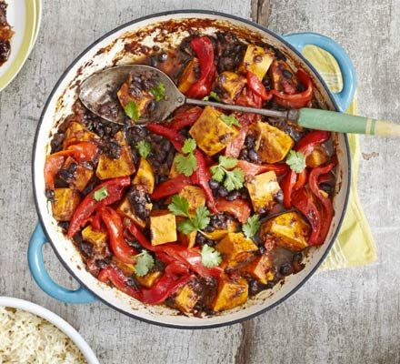 Jerk sweet potato & black bean curry. Serve your vegetable curry Caribbean style, flavoured with thyme, jerk seasoning and red peppers - great with rice and peas