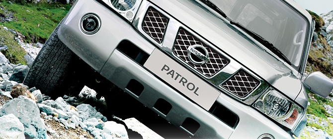 Front view of a NIssan Patrol in an off-road enviroment.