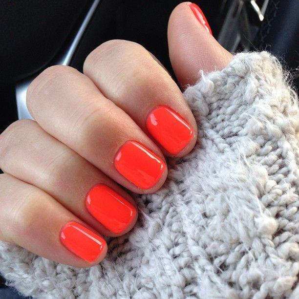 neon coral nails.