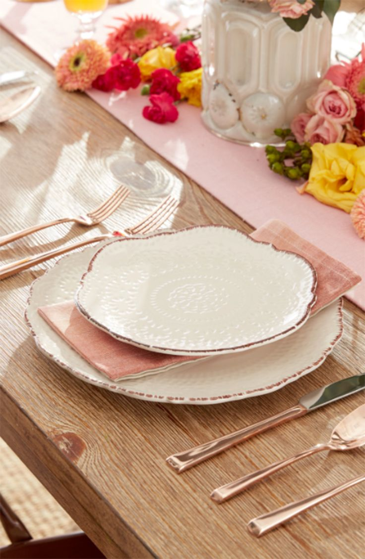 Cute Easter table setting! This Pfaltzgaff set is an everyday dinnerware set that still feels special. The delicately debossed stoneware is pretty and practical, perfect for adding charm to your table. The cream dinnerware set includes the key pieces you need to enjoy your meals in style. Plus, it's easy to care for and can be used in the microwave for added convenience.