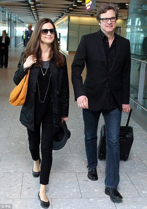 Homecoming: Oscar winner Colin Firth and his wife Livia Giuggioli arrive at Heathrow Terminal 5 after their flight from Los Angeles