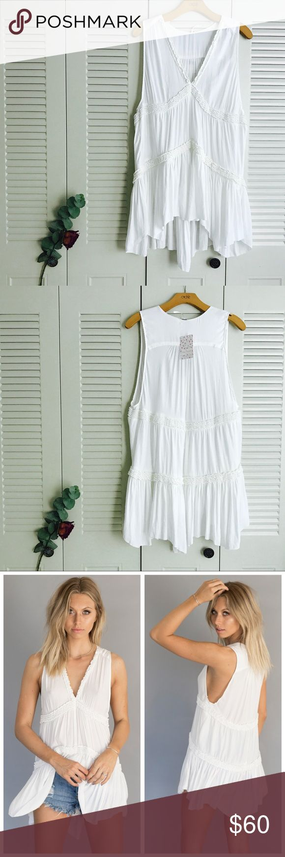 FP White Tunic Fun and boho, this white tunic top from Free People features a flowy and sleeveless styles, with layered gathered ruching.  Slightly sheer - pairs perfectly with your favorite bralette.  Can be worn as a dress on someone who is shorter.  Brand new with tags! Free People Tops Tunics