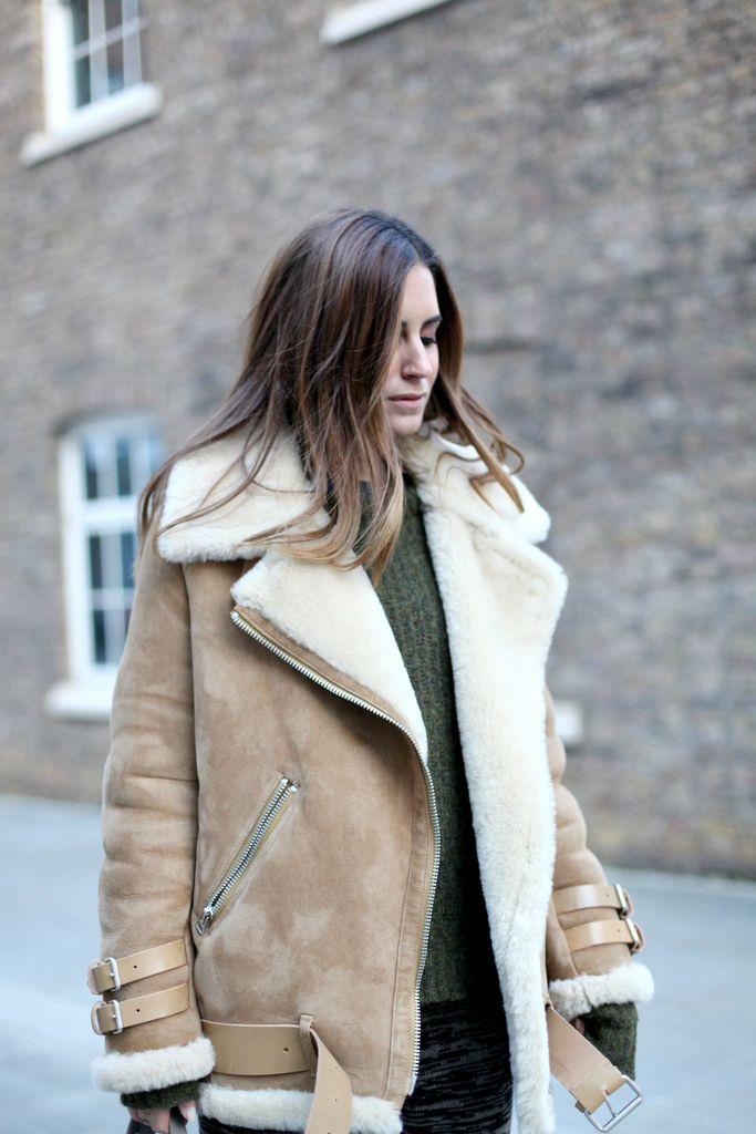 Gala Gonzalez is wearing a beige oversized shearling biker jacket from Acne Studios