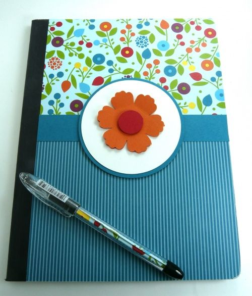 Altered composition notebook and matching pen