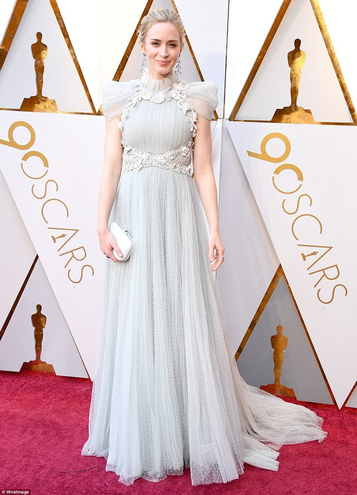 Leading the pack was 35-year-old Emily, who looked sensational in a high-neckline Victorian-inspired duck egg blue gown with tulle shoulders and frilly white bodice detailing