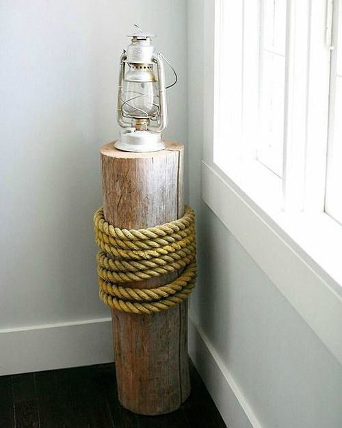 Easy diy piling decor idea with thick rope... http://www.completely-coastal.com/2016/10/nautical-piling-decor-ideas.html Add a flair of dock-side to your space!
