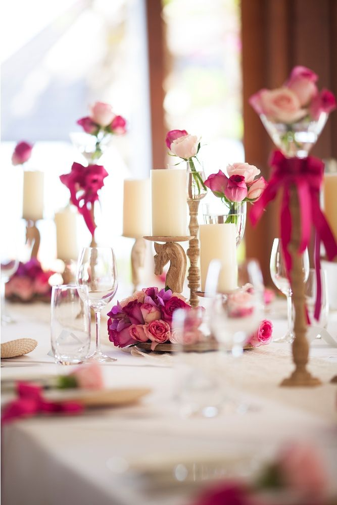 Hot pink bouquet adorning the Bridal Table 2 by Tirtha Bridal Uluwatu Bali