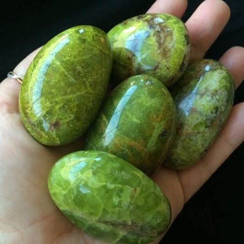 Tumbled Madagascar Green Opal is used to purify, cleanse, heal, and restore your heart chakra.  [ LavHa.com ]