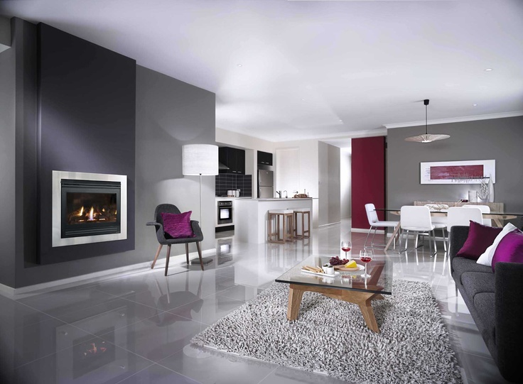 Jetmaster Heat N Glo 550TRSI 4 sided stainless steel gas fireplace.  Grey and white living room with purple accents.