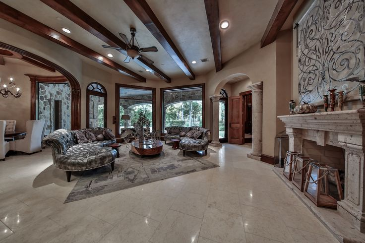 The family room at Rosewood opens to the kitchen & features a stone fireplace, built-in entertainment center, & showcases pool and golf course views, making this the ideal entertainment area at Rosewood!  #SupremeAuctions #LuxuryAuction #Houston #Dallas #Texas #HoustonRealEstate #TexasRealEstate #DallasRealEstate #Auction #LuxuryLiving #LuxuryHome #Mansion #RealEstate #LuxuryRealEstate #TheWoodlands #House #bedroom #LuxuryLifestyle #office #Rosewood #pool #idea #inspiration