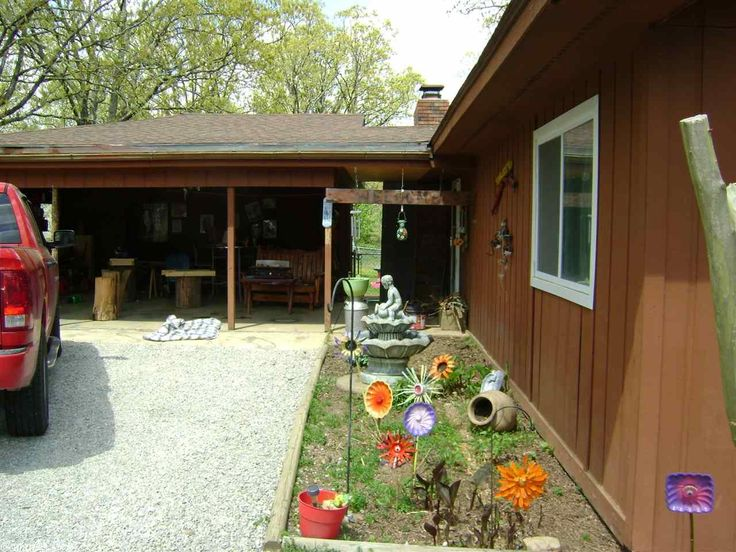 Nice Lake View Home. It has 2 bedrooms and 2 baths. Large open concept kitchen, dinning and living area with a wood burning fireplace and vaulted ceiling. This house has a screened in porch and a deck to relax on. It has a chain link fence in the backyard for the kids or pets. It has a very large carport with 3 different storage rooms. It has stainless steel appliances in the kitchen and tile and bamboo laminate floors through out. This house is priced to sell so you better get here fast…