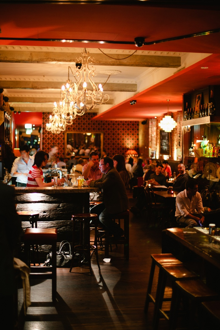 Terra Rossa in Melbourne features several distinct areas that make it perfect for versatile dining. The historic building houses a stylish interior featuring rough-hewn mahogany floors, dark wood furnishings, chesterfield lounges and candy red walls.
