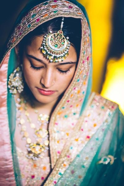 Maang Tikka - Silver Maang Tikka with Green and Yellow Stones, Blue Net Dupatta Veil | WedMeGood  #indianbride #indianwedding #maangtikka #indianjewelry #jewelry