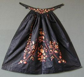 doesn't quite fit this category.....but I couldn't resist....Victorian Apron Embroidered c 1850  This apron is of black moire, the waistband pointed at the front and embroidered with a flower and leaf meander, piped, the skirt ruched into the point and embroidered with a central coral pink and straw coloured silk flower spray.