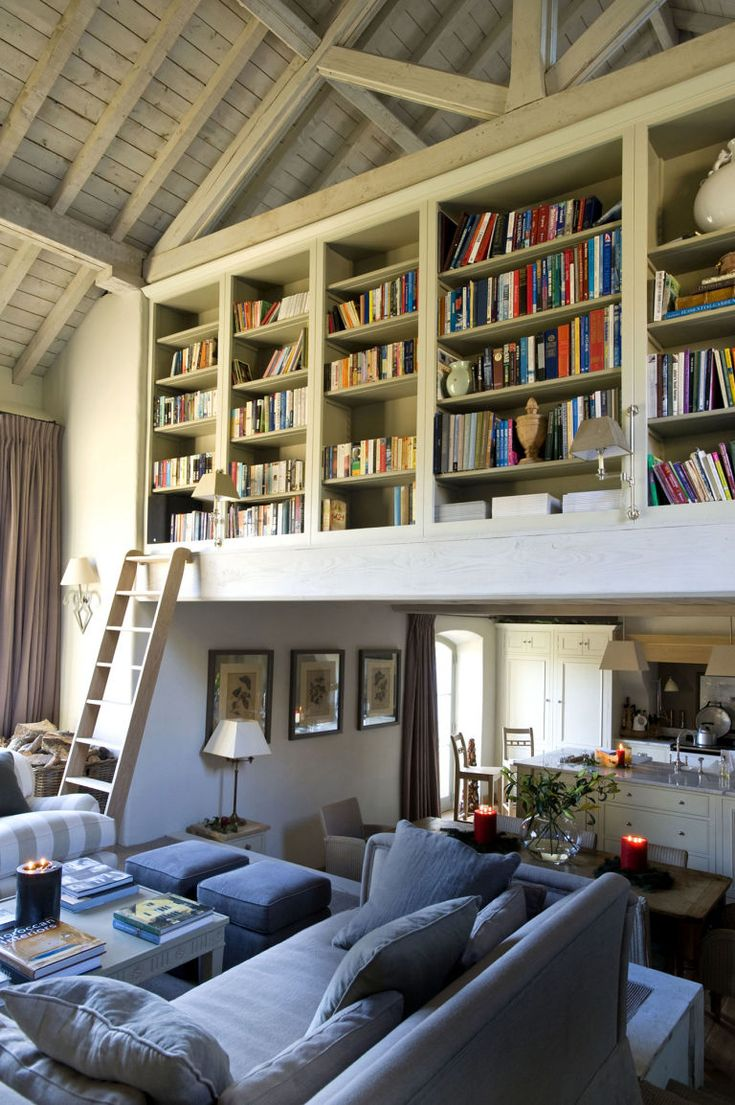 Built in bookshelves above living room with library