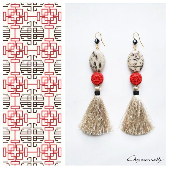 CGC029 - Chryssomally Ethnic chic gold earrings with beige jasper stones, red acrylic cinnabar, black Swarovski crystals and beige tassels.