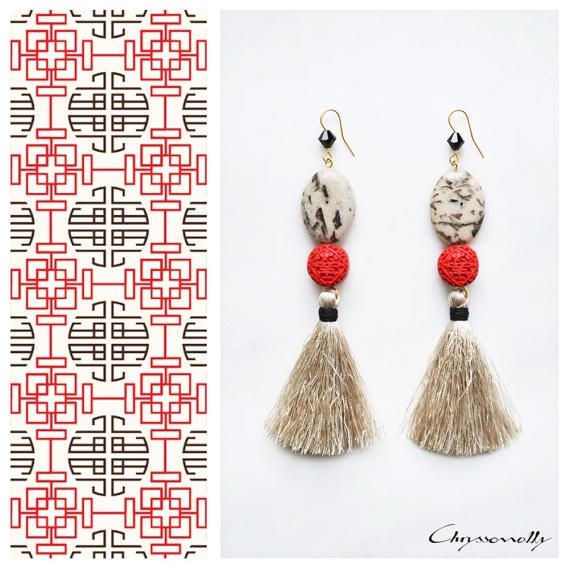 CGC029 - Chryssomally Ethnic chic gold earrings with beige jasper stones, red acrylic cinnabar, black Swarovski crystals and beige tassels.