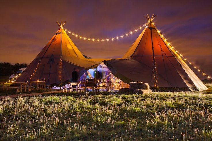Festoon lighting over two giant hat tipis by sami tipi  Image by Christopher Terry