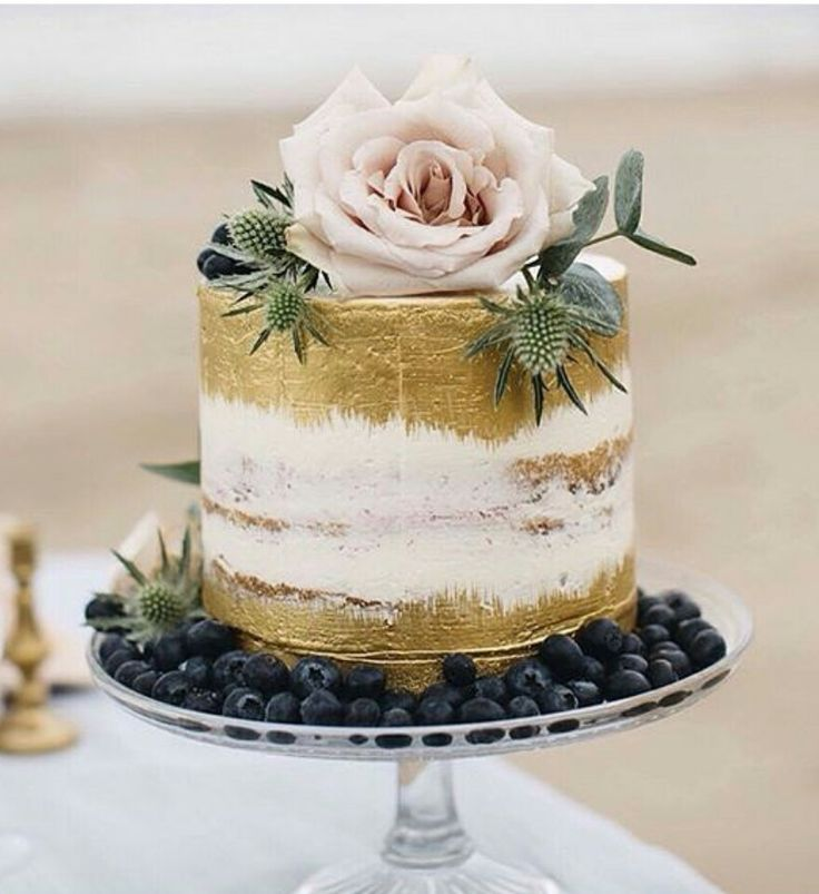 Adding a bit of gold to a semi-naked cake.