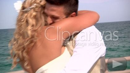 A young newlywed couple kiss by the ocean. HD Stock Footage Clip. Medium shot. 2013-05-19, UNITED STATES.