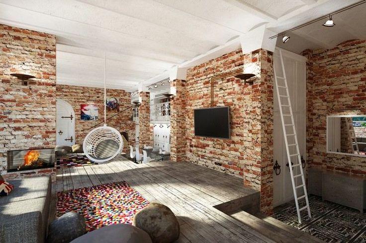 déco industrielle, papier peint effet brique, tapis multicolore, plafond bois blanc neige et fauteuil suspendu assorti